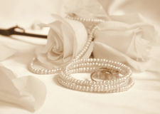 Wedding rings and roses as wedding background. In Sepia toned. R Stock Image