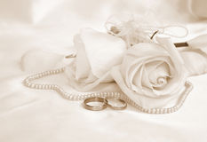 Wedding rings and roses as wedding background. In Sepia toned. R Royalty Free Stock Photo