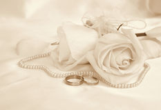 Wedding rings and roses as wedding background. In Sepia toned. R Stock Photography