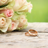 Wedding rings and roses Royalty Free Stock Photo
