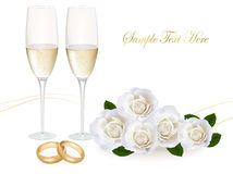 Wedding rings, roses bouquet and champagne. Stock Image