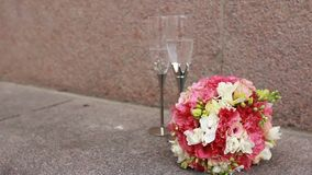 Wedding rings with roses and glasses of champagne stock video