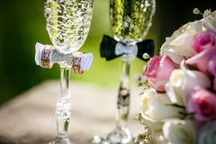 Wedding rings with roses and glasses of champagne Stock Photography