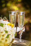 Wedding rings with roses and glasses of champagne Royalty Free Stock Photo