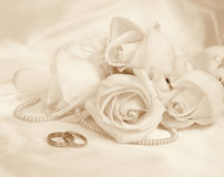 Wedding rings and roses. In Sepia toned. Retro style Stock Photos