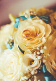 Wedding rings on roses Royalty Free Stock Image