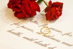 Wedding Rings with roses and vows Royalty Free Stock Photography