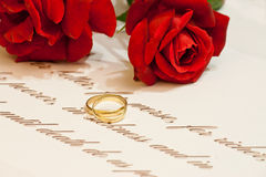 Wedding Rings with roses and vows stock photos