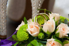 Wedding rings, roses, women`s shoes Stock Images