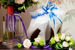 Wedding rings, roses, women`s shoes Royalty Free Stock Images