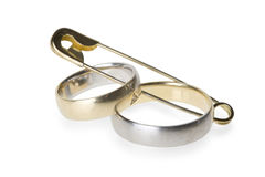 Wedding rings in safety pin Royalty Free Stock Images