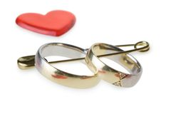 Wedding rings in safety pin Stock Images