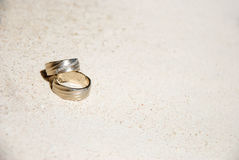 Wedding rings on sand. In the sun Stock Images