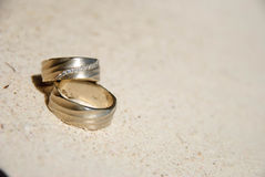 Wedding rings on sand. In the sun Royalty Free Stock Images