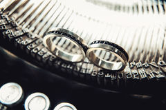 Wedding rings with sapphires on a vintage typewriter Stock Photo