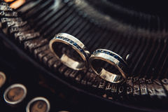 Wedding rings with sapphires on a vintage typewriter Stock Image