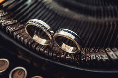 Wedding rings with sapphires on a vintage typewriter Stock Photography