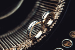 Wedding rings with sapphires on a vintage typewriter Royalty Free Stock Images