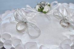 Wedding rings on satin pillow Royalty Free Stock Photos