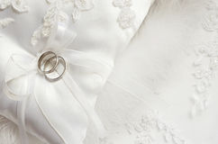 Wedding rings on satin pillow Royalty Free Stock Photography