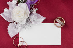 Wedding rings and satin rose with card Stock Image
