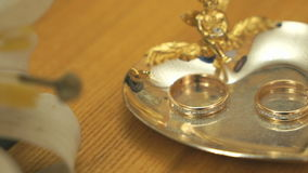 Wedding rings on the saucer in a registration hall stock video