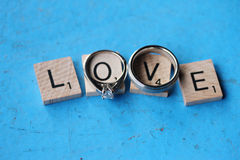 Wedding Rings on Scrabble LOVE letters Royalty Free Stock Image
