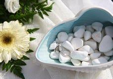 Wedding rings on sea pebbles Stock Image