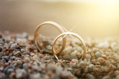 Wedding rings. On sea sand.  close up Royalty Free Stock Images