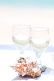 Wedding rings on seashell and glass of champagne Stock Image