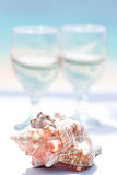 Wedding rings on seashell and glass of champagne Royalty Free Stock Image