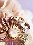 Wedding Rings. A set of beautiful diamond wedding rings on flower bouquet background Royalty Free Stock Images