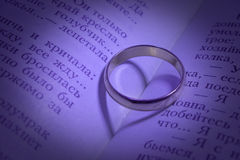 Wedding rings and shades in the form of heart Royalty Free Stock Photography