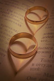 Wedding rings and shades in the form of heart Stock Image