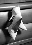 Wedding rings and shoes bride Royalty Free Stock Image