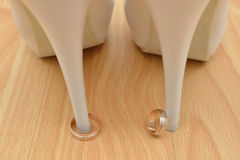 Wedding rings and shoes Royalty Free Stock Photo