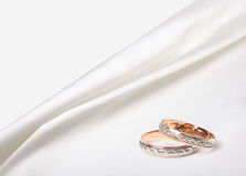 Wedding rings on silk background Stock Photos