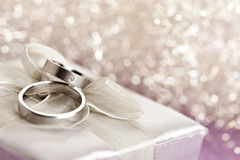 Wedding rings on silver giftbox Stock Photos