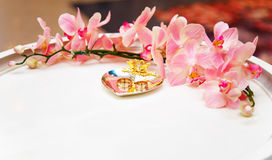 Wedding rings on silver plate with flower diadem Royalty Free Stock Photos