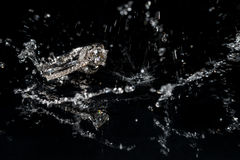 Wedding Rings Sinking in Water, Black Background Royalty Free Stock Photo