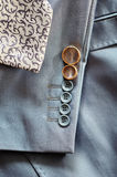 Wedding rings on the sleeve of his jacket the groom Stock Image
