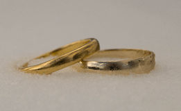 Wedding Rings Among The Snow Stock Images