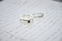 Wedding rings on speech stock photos