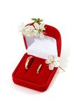 Wedding rings and spring flowers Royalty Free Stock Photo