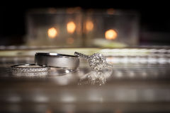 Wedding rings stacked on beautiful background. At reception Royalty Free Stock Photo