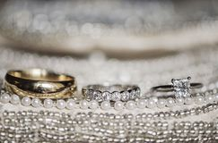 Wedding rings on sequins and pearls Royalty Free Stock Photography