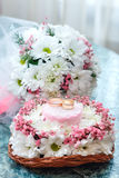 Wedding rings on a stand of flowers and a bridal bouquet of cham Royalty Free Stock Images