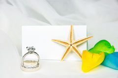 Wedding rings and starfish on tulle Stock Photo
