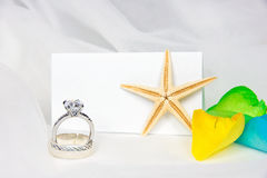 Wedding rings and starfish on tulle Royalty Free Stock Photos
