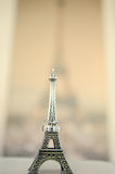 Wedding rings on a statue of the Eiffel Tower. On the background image of the Eiffel Tower Royalty Free Stock Image